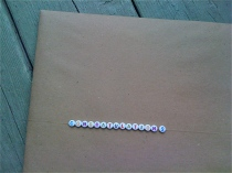 Present wrapped in craft paper with beaded message