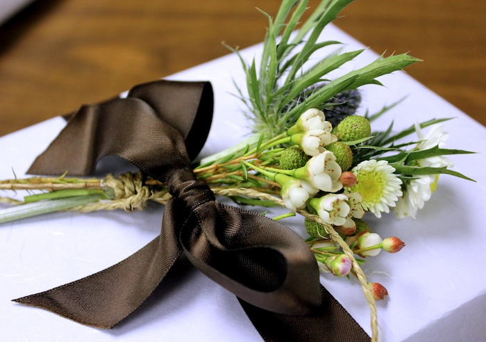 Present topped with thistle posy from Coriander Girl