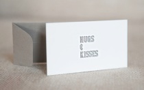 Hugs and Kisses letterpress gift tag in black, by Farmwood Press