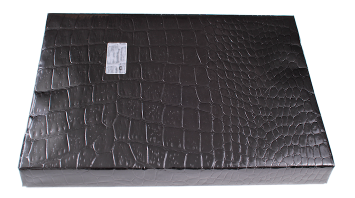 Gift wrapped in black alligator-textured paper