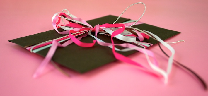 gift card in an envelope tied with ribbons