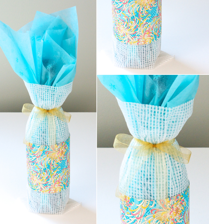 layering tissue paper: Wine bottle wrapped in two layers of tissue and band of patterned paper