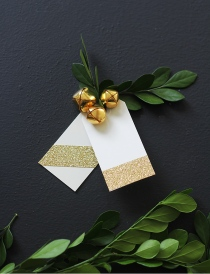 Glitter tags with gold bells from Little House Blog