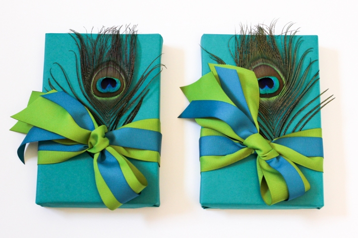 Custom gift packaging for Tavanberg Communications: Peacock feathers and teal wrapping | by Corinna vanGerwen, gift stylist
