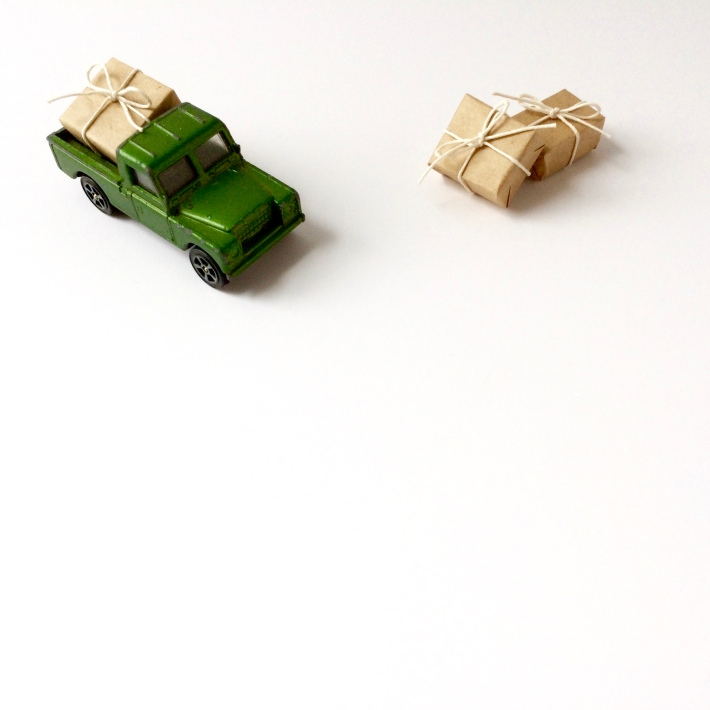 Miniature toy truck moving gifts
